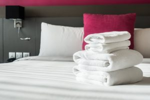 folded-towels-bed_1203-973